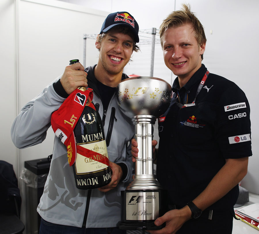 Sebastian Vettel with the spoils of victory