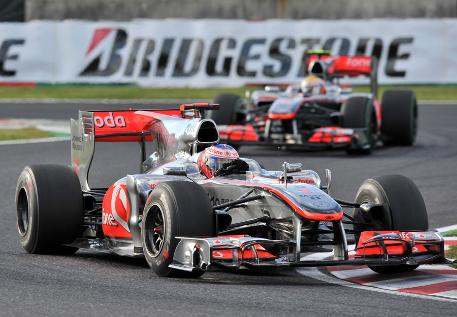 Jenson Button leads Lewis Hamilton early in the race
