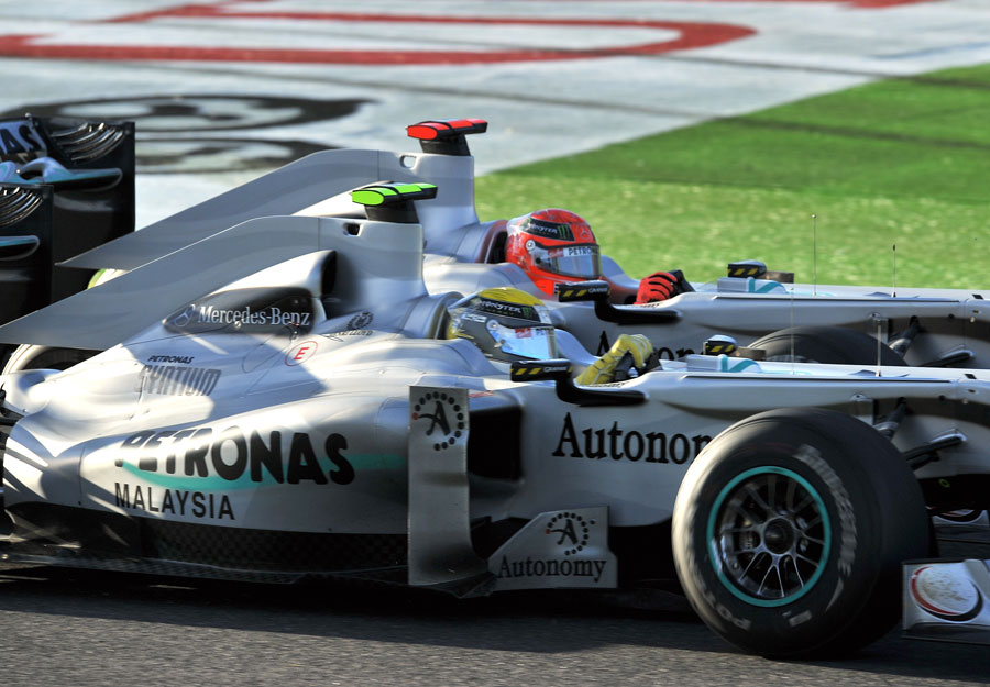 Nico Rosberg and Michael Schumacher battle for position at Suzuka