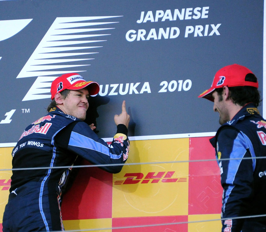 Sebastian Vettel shows team-mate Mark Webber who is number one in Suzuka