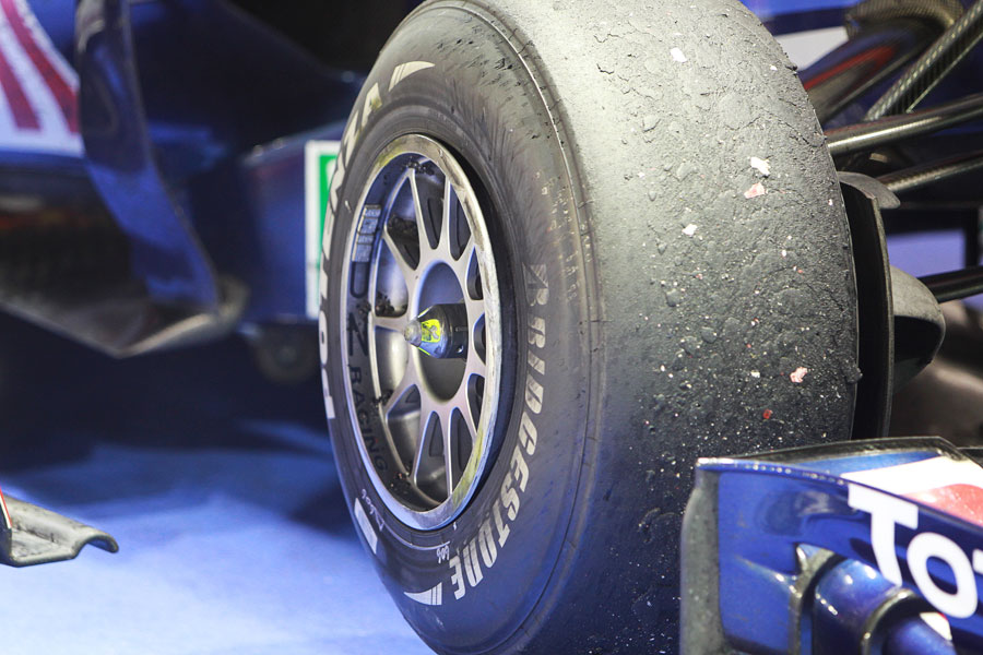 A photograph shows how close Mark Webber's tyre was to coming off