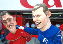 Michael Schumacher and Jacques Villeneuve caricatures fight in the pit lane