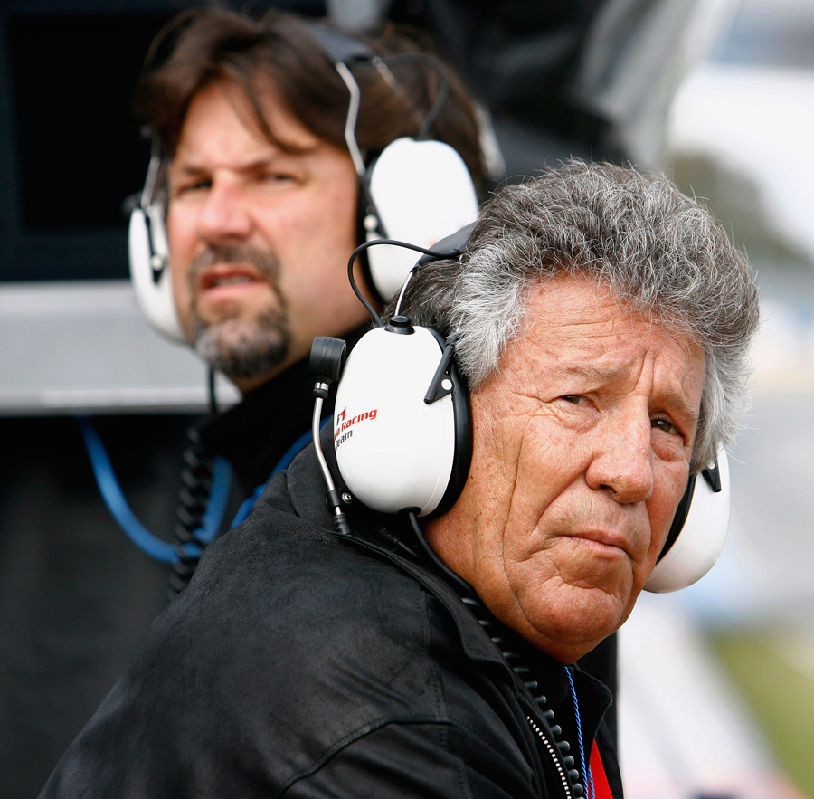 Mario Andretti and his son Michael Andretti look on as Marco Andretti, the son Michael, tests for Honda