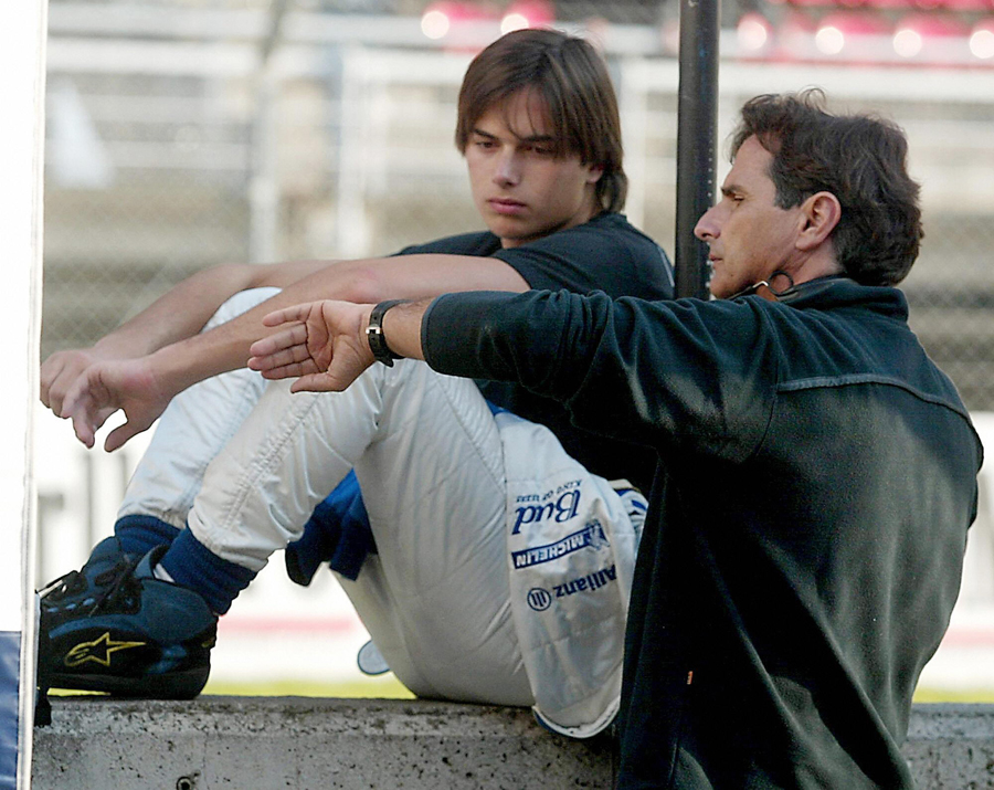 Nelson Piquet and his son chat
