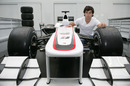 Sergio Perez gets a close-up look at the Sauber on a factory visit