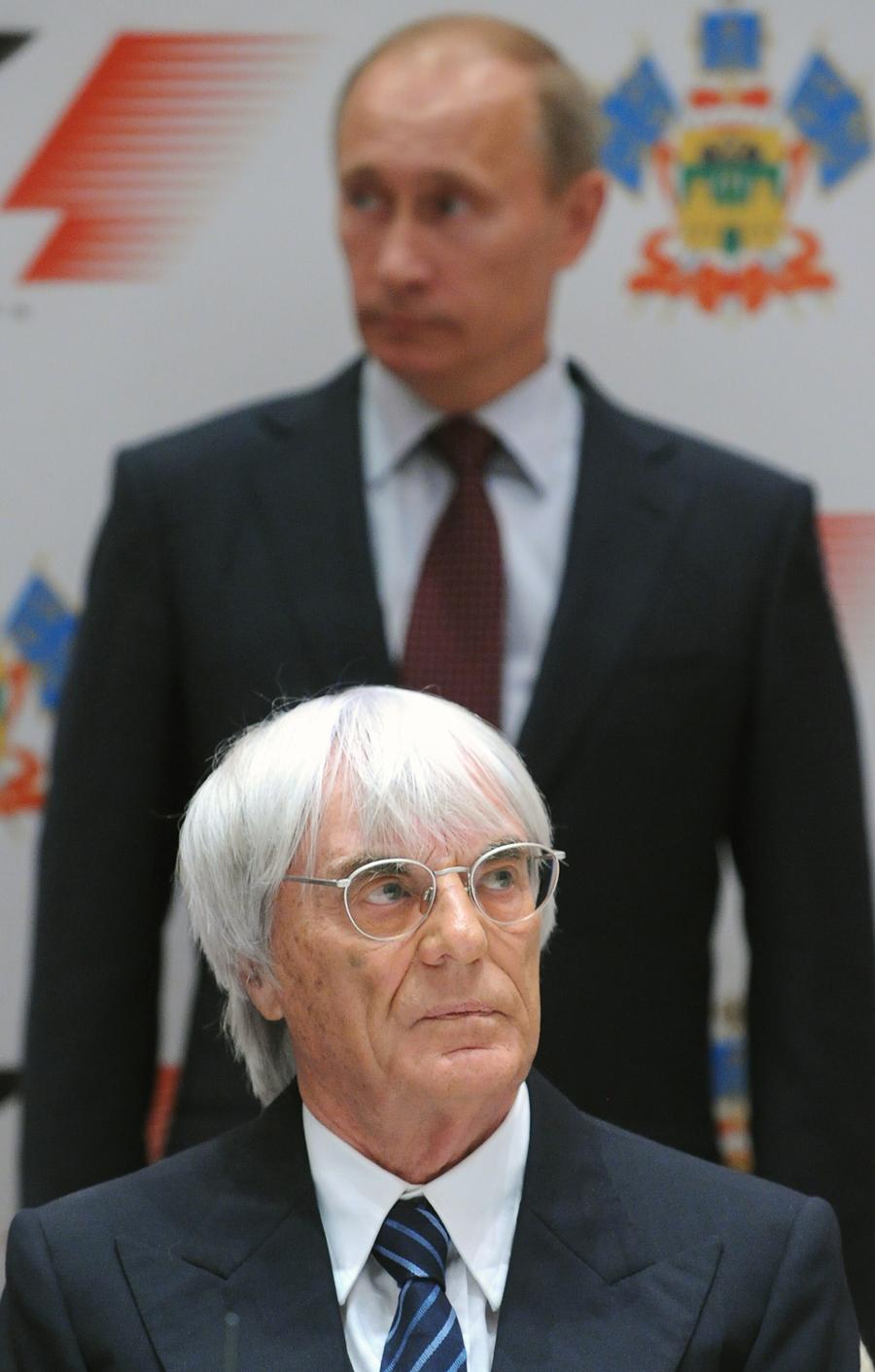 Bernie Ecclestone and Russian Prime Minister Vladimir Putin attend a ceremony