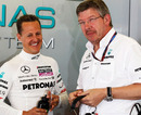Michael Schumacher shares a joke with Ross Brawn