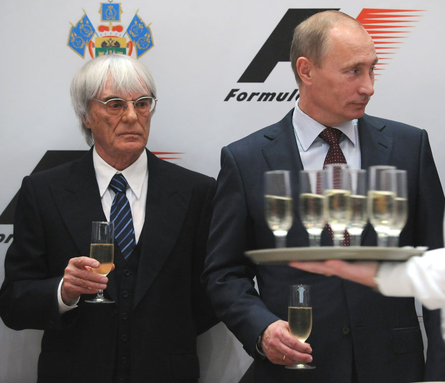 Bernie Ecclestone and Russian Prime Minister Vladimir Putin attend a ceremony