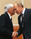 Bernie Ecclestone and Russian Prime Minister Vladimir Putin shake hands