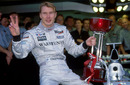 Mika Hakkinen celebrates winning the first of his two world titles