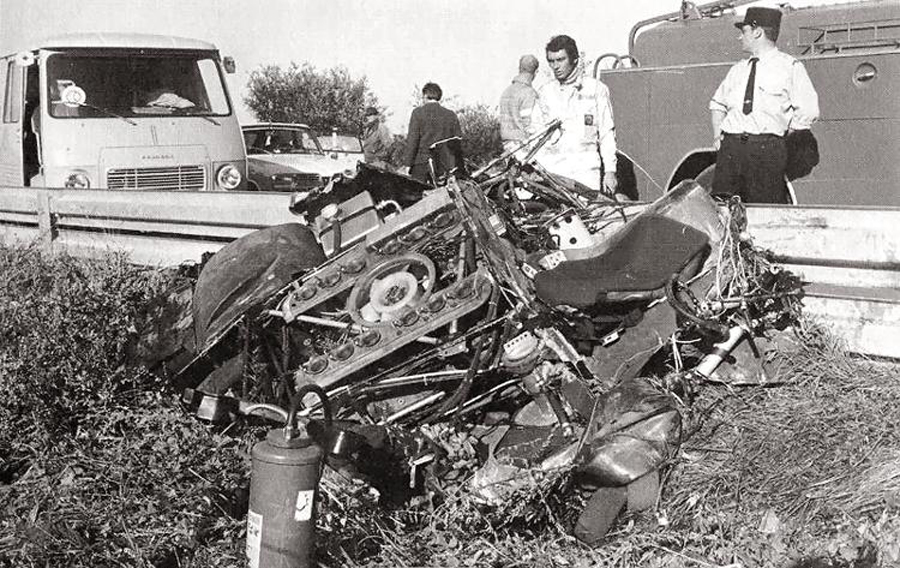 Steve McQueen surveys the wreckage of David Piper's Porsche after the crash during filming of <I>Le Mans</I>