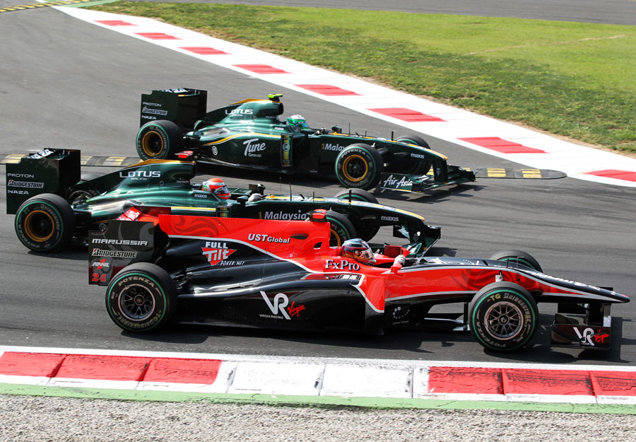Timo Glock, Jarno Trulli and Heikki Kovalainen come out of the first chicane side-by-side