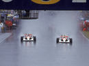 Gerhard Berger and Ayrton Senna lead the field away in atrocious conditions in Adelaide