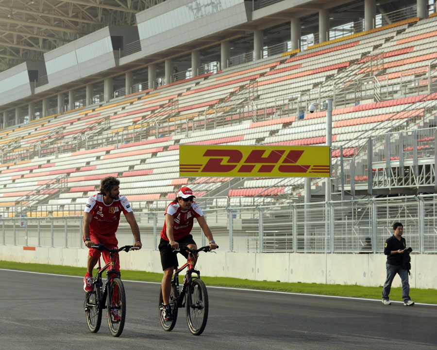 Fernando Alonso cycles the circuit for the first time