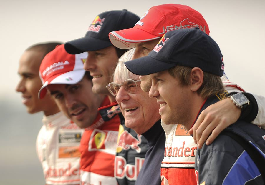 The title contenders pose with Bernie Ecclestone
