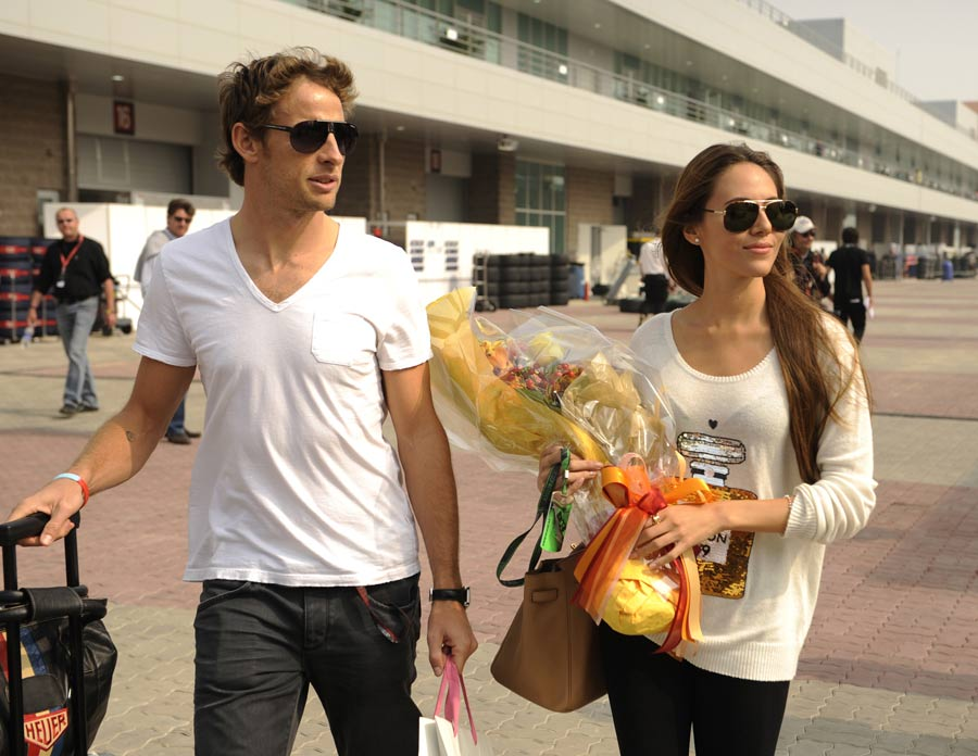 Jenson Button arrives at the circuit with girlfriend Jessica Michibata