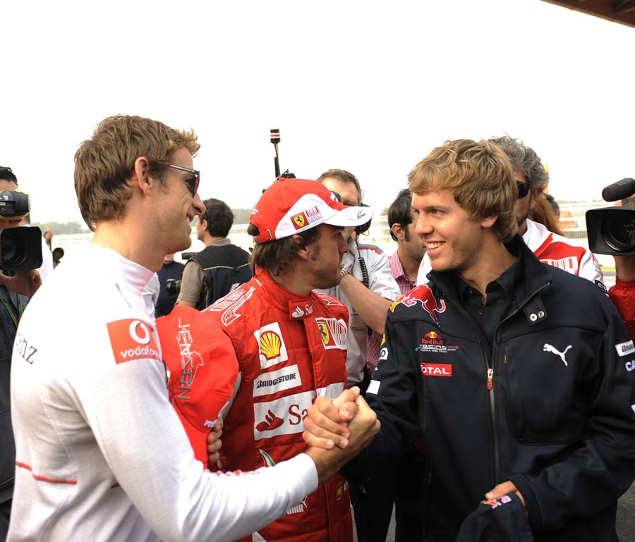 Jenson Button greets Sebastian Vettel on Thursday