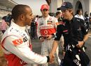 Lewis Hamilton greets title rival Sebastian Vettel