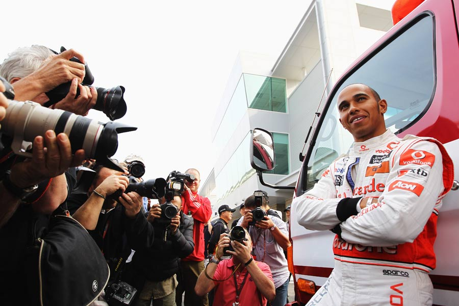 Lewis Hamilton poses for photographers