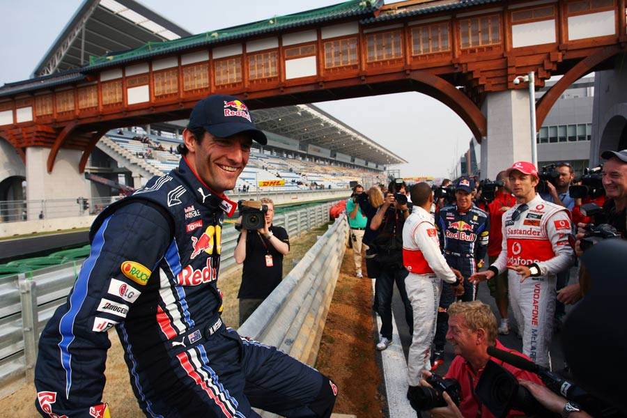 Mark Webber gets ready to pose for photos on the barrier
