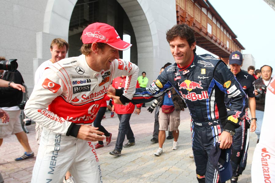 Mark Webber and Jenson Button engage in some playful banter