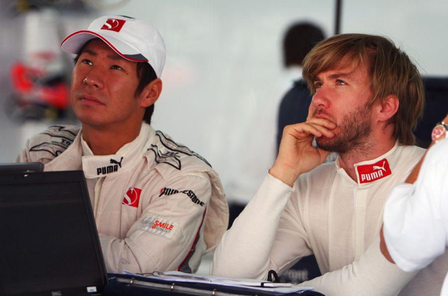Kamui Kobayashi  and Nick Heidfeld keeps tabs on the data