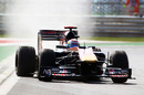 Sebastien Buemi kicks up dust in his Toro Rosso