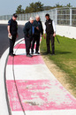 The FIA's Herbie Blash and Charlie Whiting inspect the final corner