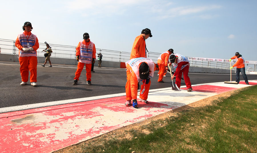 Workmen address issues at the final corner