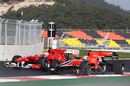 Felipe Massa  passes Virgin reserve driver Jerome d'Ambrosio