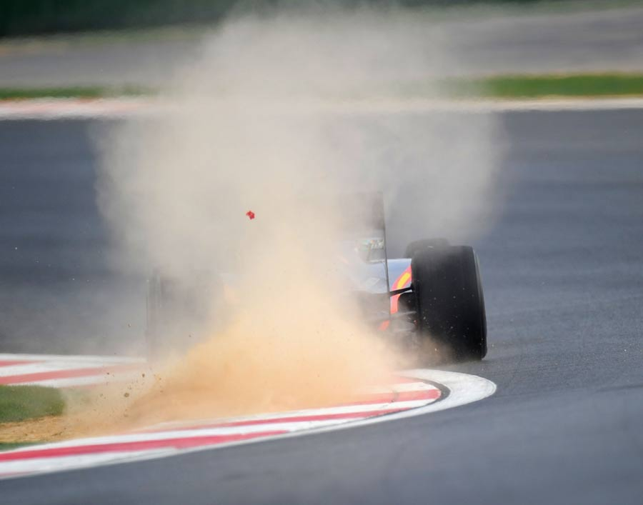 Sakon Yamamoto drags dirt onto the track