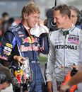 Sebastian Vettel shares a joke with Michael Schumacher