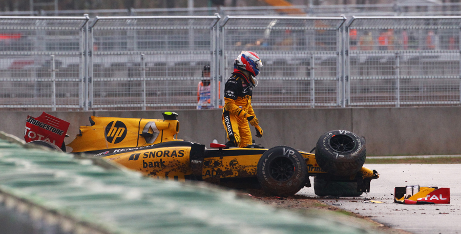 Vitaly Petrov climbs out of his wrecked Renault