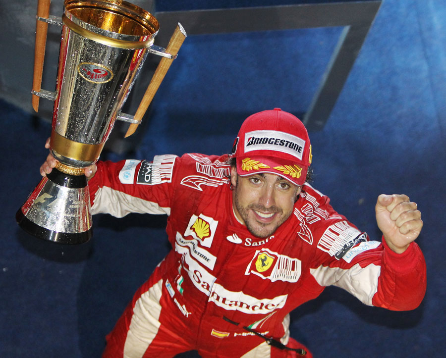 Fernando Alonso with his winner's trophy
