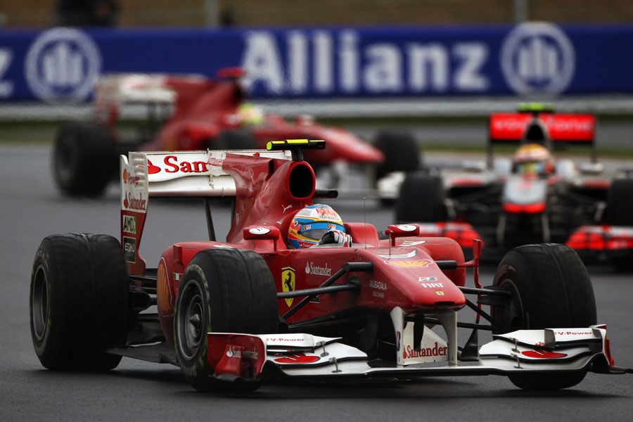 Fernando Alonso leads Lewis Hamilton and Felipe Massa