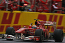 Fernando Alonso crosses the line to take victory