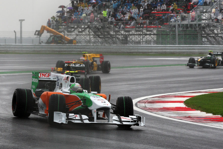 Tonio Liuzzi holds a huge slide in his Force India