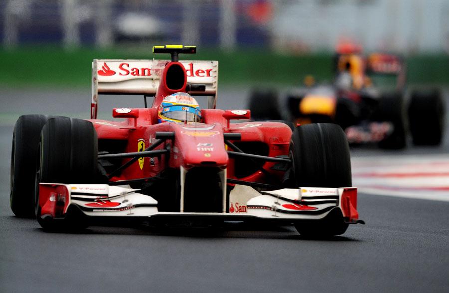 Fernando Alonso leads Sebastian Vettel