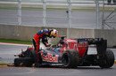 Sebastien Buemi climbs out of his wrecked Toro Rosso
