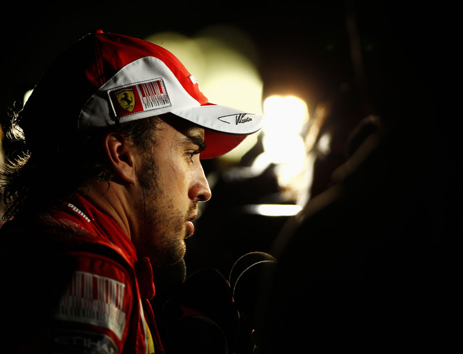 Fernando Alonso talks to the press after the race
