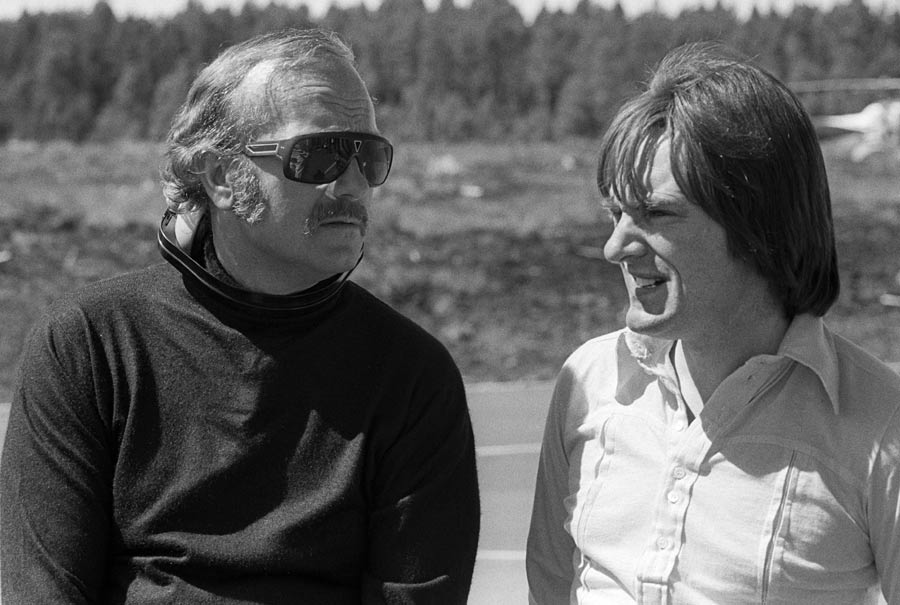 Lotus team owner Colin Chapman with Brabham team owner Bernie Ecclestone at the 1973 Swedish Grand Prix