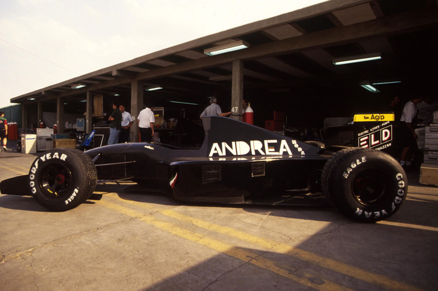 An Andrea Moda in the pit lane