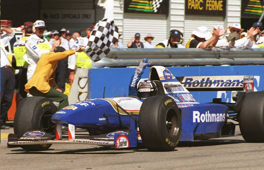 Damon Hill celebrates winning the 1995 Australian Grand Prix by a massive margin of over two laps