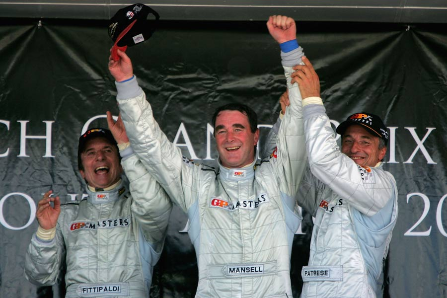 Nigel Mansell celebrates winning the Grand Prix Masters in Kyalami with Emerson Fittipaldi and Ricardo Patrese