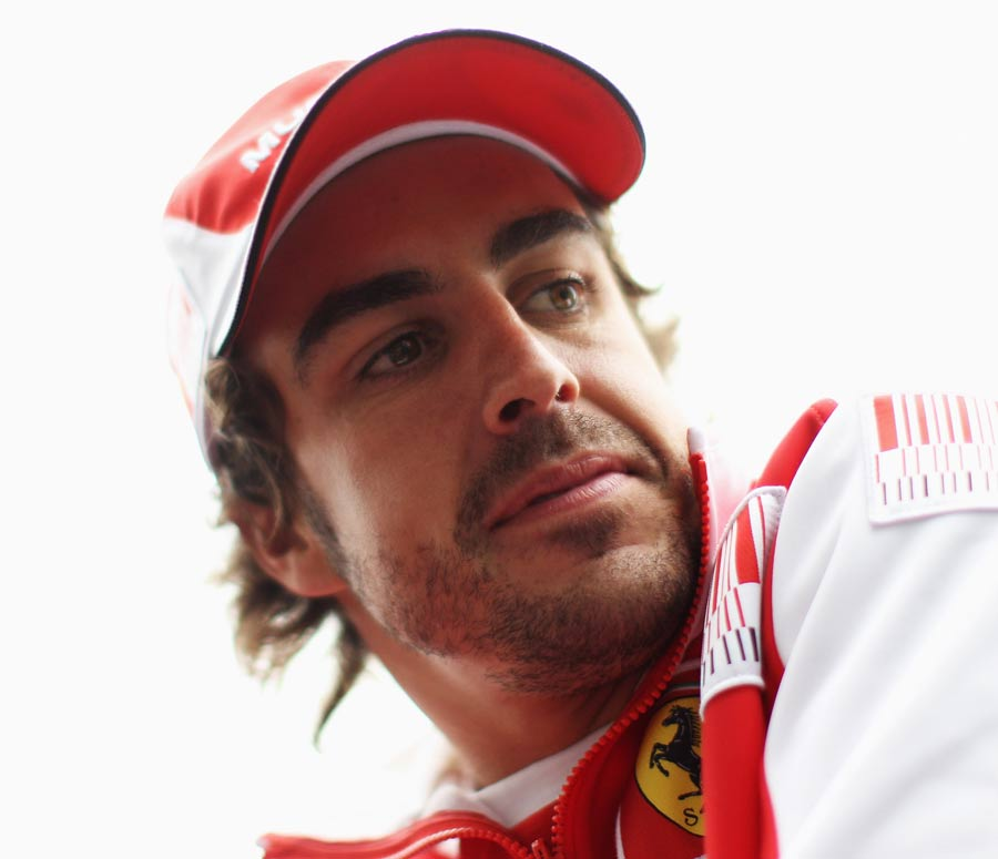 Fernando Alonso looks on during the drivers' parade