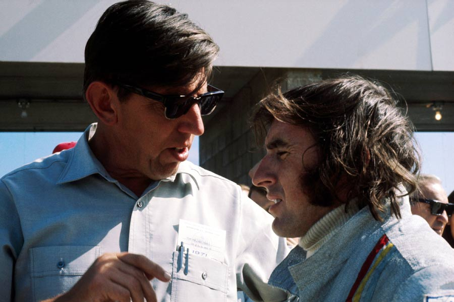 Ken Tyrrell talks to pole sitter Jackie Stewart before the United States Grand Prix