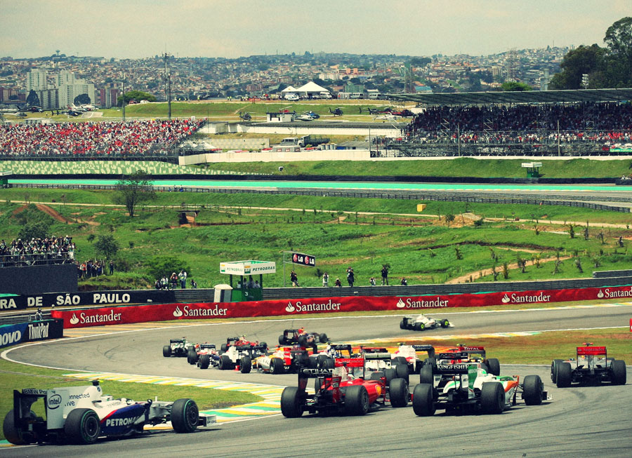 Cars file through the Senna Esses