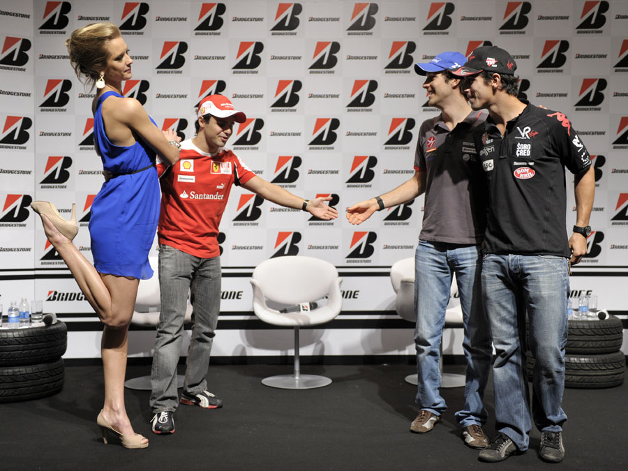 Brazilian drivers Felipe Massa, Lucas di Grassi and Bruno Senna pose for a photo with model Gianne Albertoni