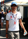 Bruno Senna walks through the paddock