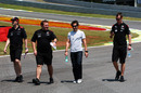 Timo Glock and his Virgin Racing engineers walks the track